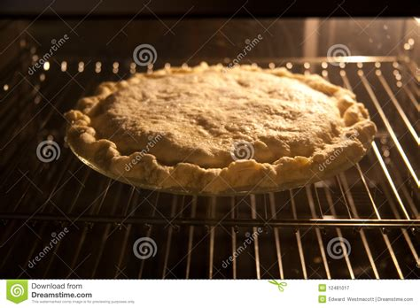 Apple Pie In Oven Royalty Free Stock Photography