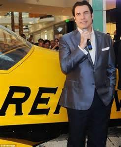 John Travolta reveals bizarre mini beard and full head of