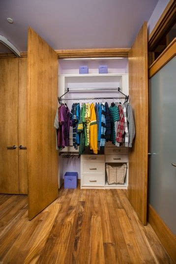 Finds Living In Closet by Closets Automated Racks That Raise And Lower For