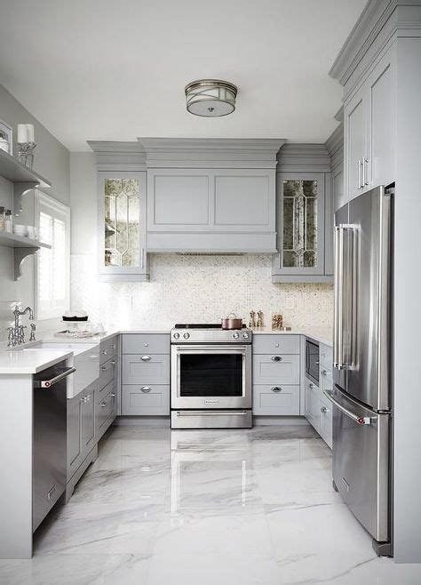gray kitchens cabinets this gray u shaped kitchen features a gray paneled 1329