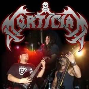 Mortician Chainsaw Dismemberment