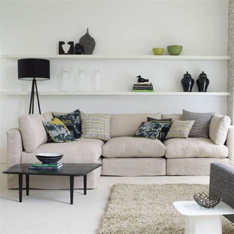 white living room with floating shelves interior design