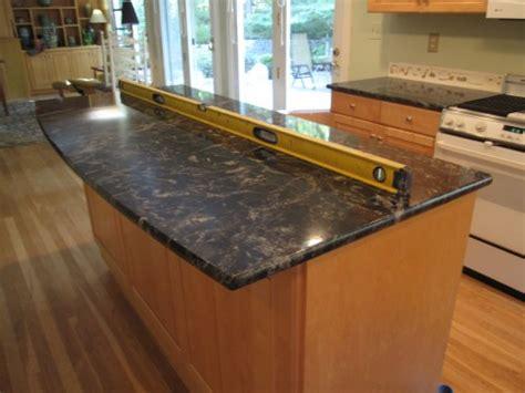 i black granite countertops and maple