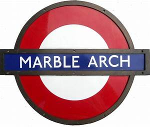 An enamel London Underground station sign with a brass ...