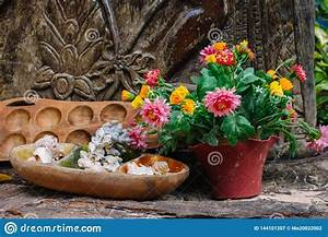 Blooming, Flowers, In, Pot, With, Wooden, Candle, Stand, And, Outdoor, Decor, Patio, Design, Details, Garden
