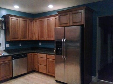 kitchen remodel dark granite cherry cabinets teal