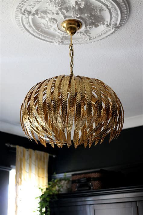 my new gold glam light fixture in the bedroom swoon worthy