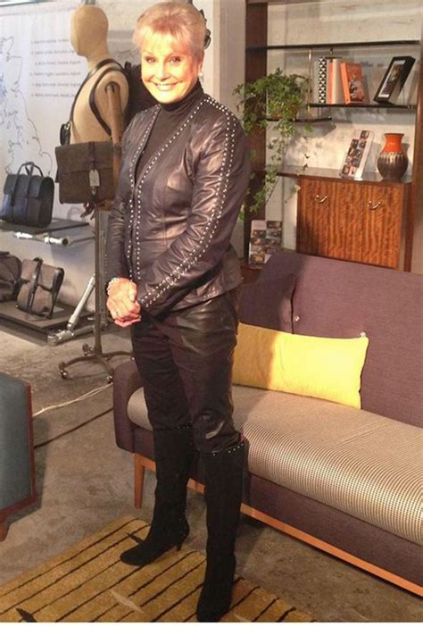 angela rippon wears  leather outfit  gplan furniture