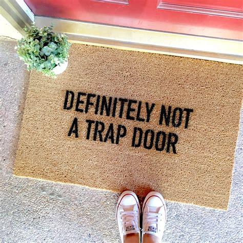 witty doormats the quot this is not a trap door quot doormat doormats