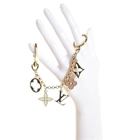louis vuitton gold pochette fleur de monogram lv bag charm chain key ring luxury handbag