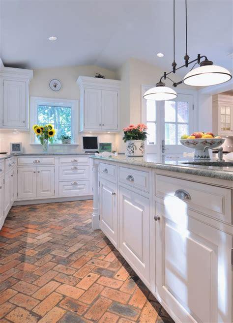 basic white kitchen  brick flooring holds  heat