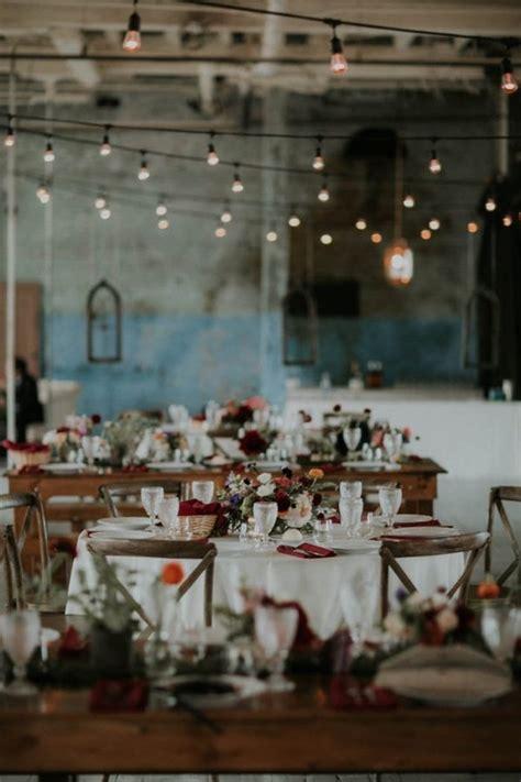 rustic industrial glam reception tables  warehouse venue