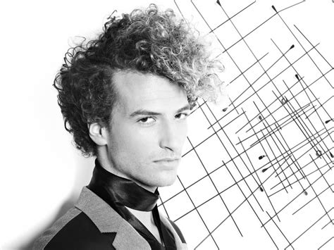 curly mens hairstyle   high rising front  long bangs