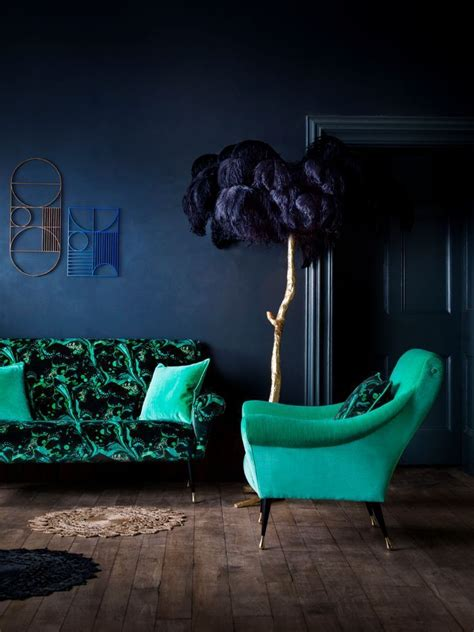 dark blue living room  jade green chair pantone