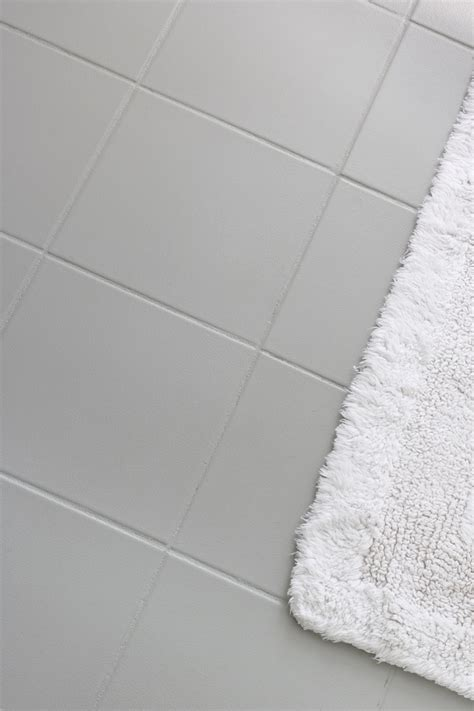 painting kitchen cabinets light gray how i painted our bathroom 39 s ceramic tile floors a simple