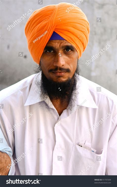 September 22: Sikh Devotee With Orange Turban At