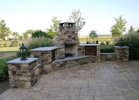 Custom Outdoor Fireplace With Wood Storage And Patio