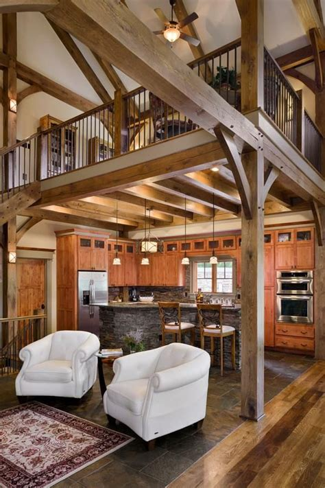 open floor plan complements  high ceilings   timber frame kitchen rustic house