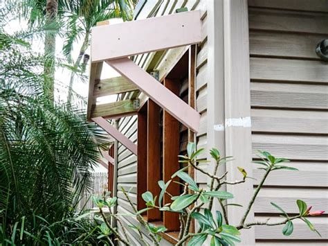 window awnings constructed  built   seamlessly integrated  existing house cairns