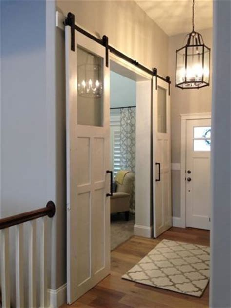 sliding barn doors with glass like the simple glass we could make this work for our