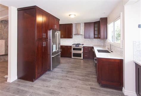 The prefinished planks work best with nails, but you can use approved glue as well. gray wood floors, warm cherry cabinets, white counters ...