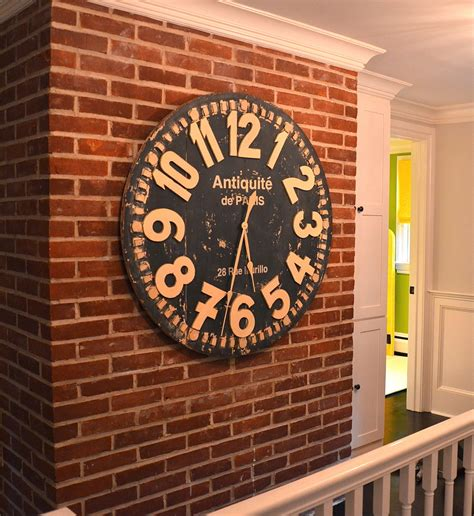 oversized wall clocks in dining room modern with mansion interior design next to ceiling