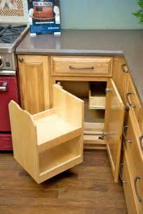 the blind corner cabinet above makes better use of corner space and stores more goods than