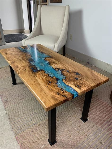 How much does a river table cost? Buy A Cherry Epoxy Resin Coffee Table For $2,100   Sturdy Metal Legs
