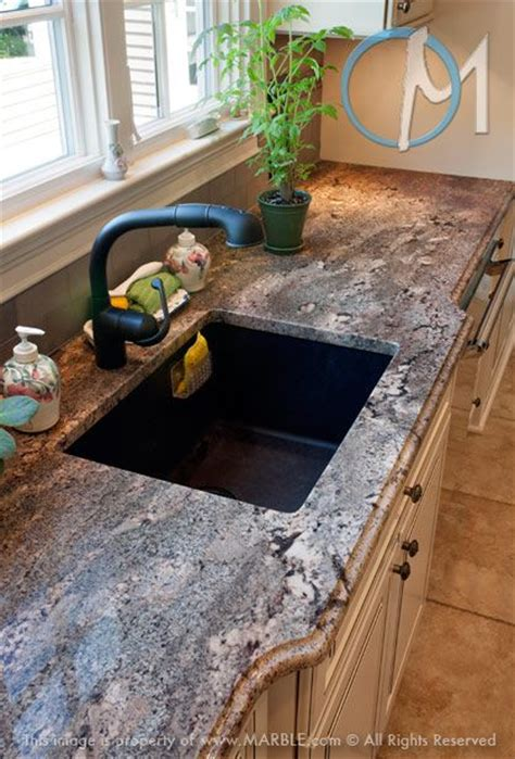 the black faucet and sink compliment the specks