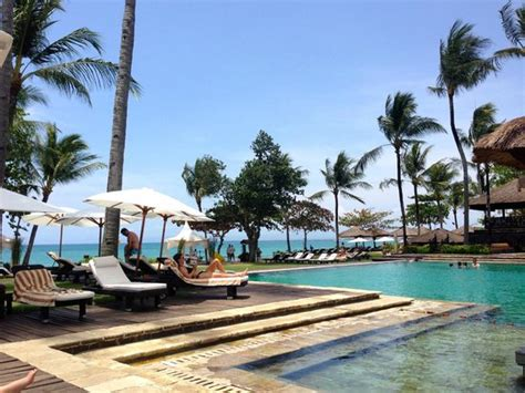 Pool Area With Ocean In Background