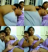 Uncle feeding breast of wife