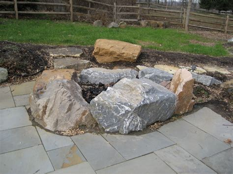 outdoor project features hardscaping boulders