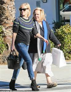reese witherspoon wears christmassy sweater to stock up for thanksgiving daily mail
