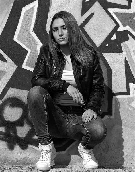 Royalty Free Photo Grayscale Photography Of Woman Wearing Leather Jacket And Jeans With Pair Of