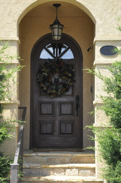 spanish style front entry  arched front door elegant
