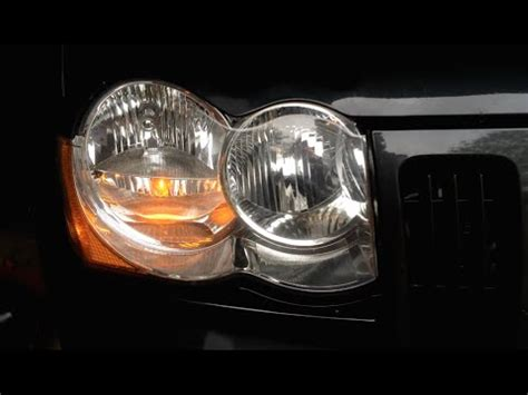 how to jeep grand headlight bulb replacement