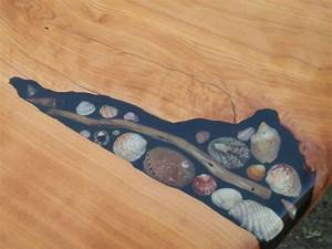 Artists Fill Tables' Cracks With Sea Shells, Stones And