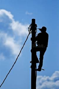 Man Working On Pole Stock Photo