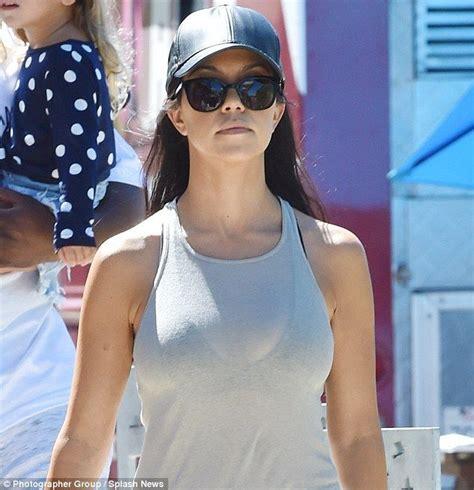 Kourtney Kardashian exposes black bra with see-through ...