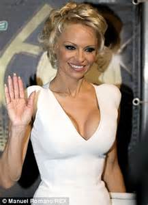 Pamela Anderson Shows Long Locks In NYC With Rick Salomon