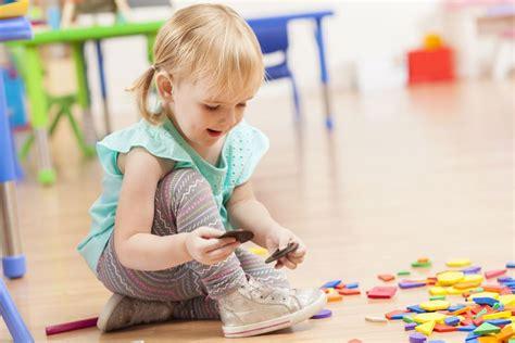 toys playing toddler cute three daycare floor five getty goodstart debenport steve