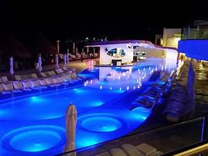 Party pool and hotel at night - Picture of Temptation ...