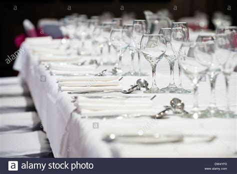 wine glass placement on table a shallow focus image of a banquet tables place settings