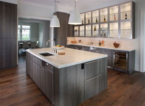 green gray cabinets light up this compact kitchen in a