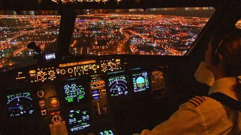 emirates boeing  night stunning landing cockpit view