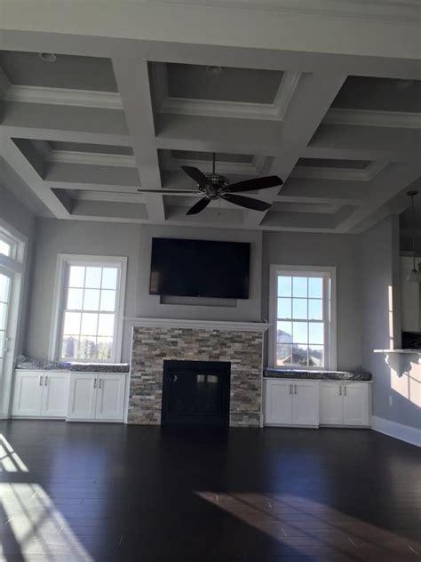 gray living room  dark hardwood floors stacked stone