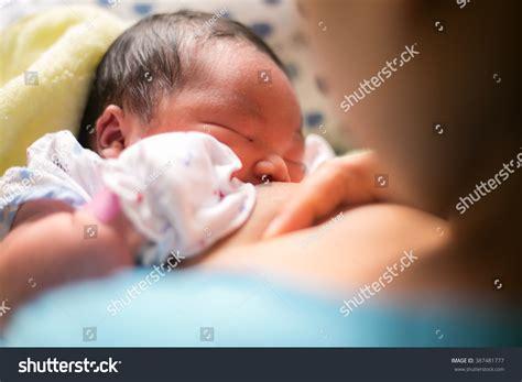 Breastfeeding Mother Holding Newborn Baby Embrace Stock