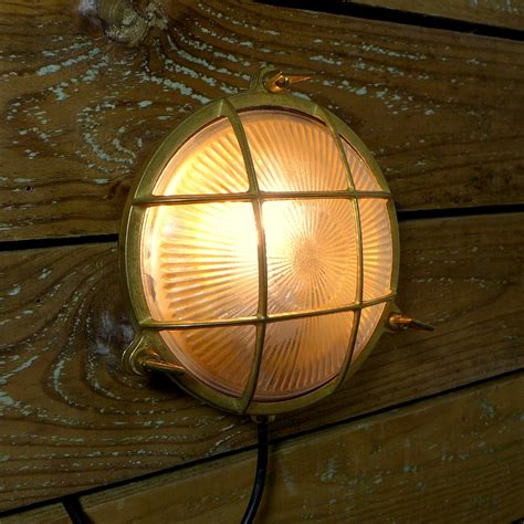 marine brass caged bulkhead wall light