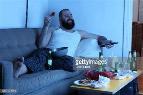 Couch Potato Man With Tv Remote Stockfoto  Getty Images