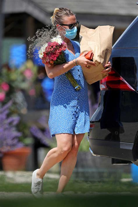 scarlett johansson   blue mini dress picks  flowers